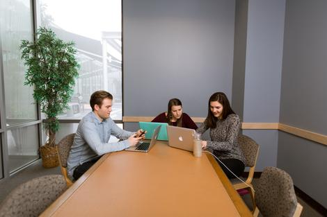 Students in a library study room