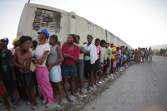 photo of Hatians standing in a long line